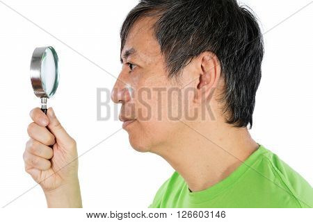 Asian Chinese Man Looking Through A Magnifying Glass