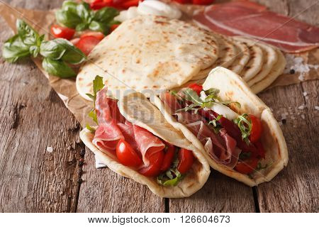 Tasty Italian Piadina Stuffed With Ham, Cheese And Vegetables Close-up. Horizontal