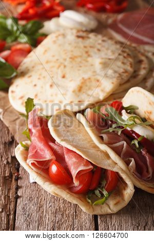 Italian Piadina Flatbread Stuffed With Ham And Vegetables Close-up. Vertical