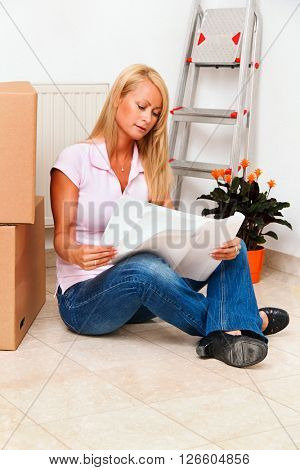 woman with plan in new apartment