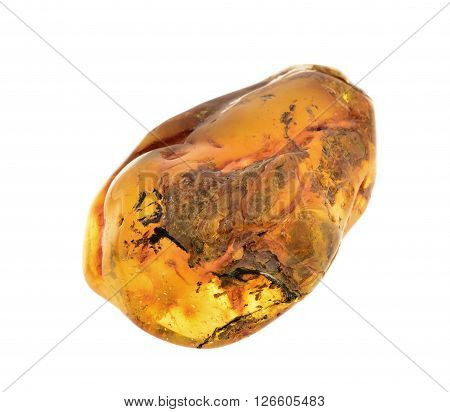 piece of baltic amber isolated on white background