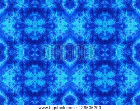 Hand-dyed blue and turquoise fabric with zig zag stitch detail and in a seamless repeat pattern