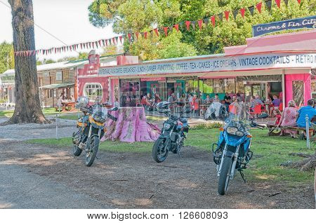 STORMS RIVER SOUTH AFRICA - FEBRUARY 28 2016: A street scene with motorcycles and a restaurant in Storms River town in the Eastern Cape Province
