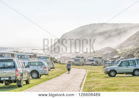 STORMS RIVER MOUTH SOUTH AFRICA - FEBRUARY 28 2016: Cars and caravans at the rest camp at Storms River Mouth with fog moving in from the sea