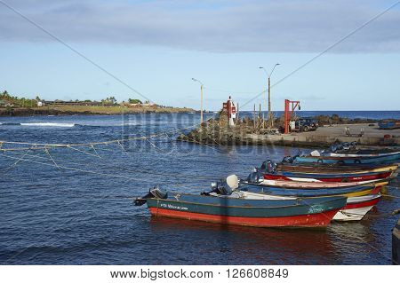 HANGA ROA, EASTER ISLAND, CHILE - APRIL 7, 2016: Fishing boats in a small harbour in HANGA ROA, capital of Easter Island.
