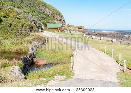 STORMS RIVER MOUTH SOUTH AFRICA - FEBRUARY 28 2016: A mountain stream camping sites and chalets at the rest camp at Storms River Mouth