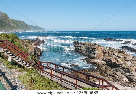 STORMS RIVER MOUTH SOUTH AFRICA - FEBRUARY 28 2016: A Staircase in front of the restaurant at Storms River Mouth with the Indian Ocean in the back