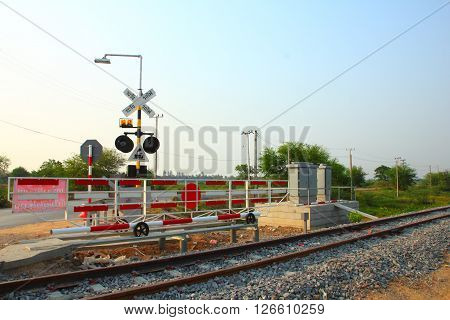 Railroad crossing sign in the morning in Thailand