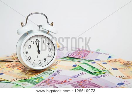 Old alarm clock for euro paper currency