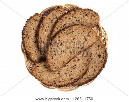 Sliced bread with sunflower seeds raisins and nuts in plate isolated on white background top view
