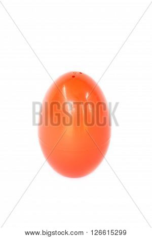 Red plastic egg on white background stock photo