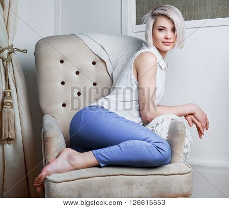 beautiful young model on the sofa