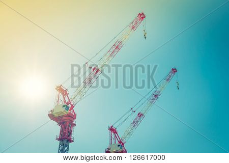 Crane and building construction site ( Filtered image processed vintage effect. )