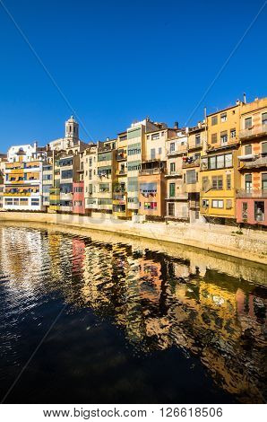 Bright colored houses on the bank of the river in Girona