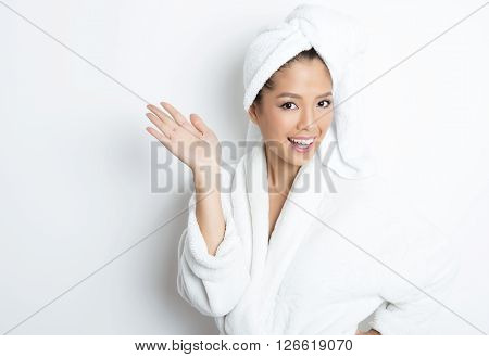 beautiful young asian woman with flawless skin and dark hair posing in bath robe