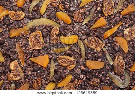 close-up chocolate texture background pattern with chocolate texture, figs, dried apricots