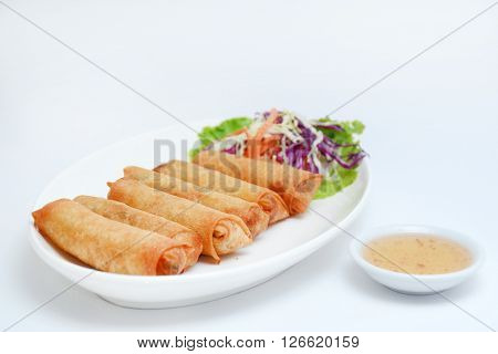 Prawns Spring Rolls with salad and sweet dipping of Thai style.