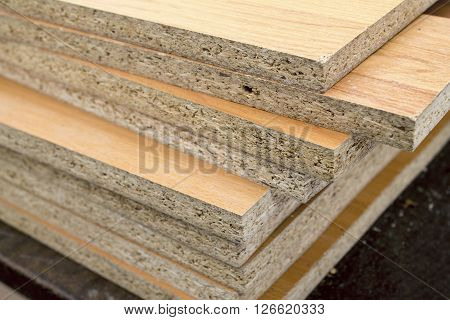 Chipboard folded in a pile heap wood panel