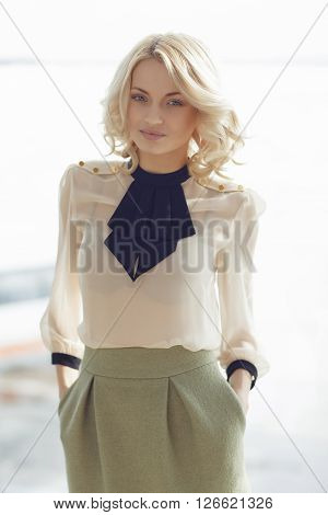 Beautiful blonde woman in stylish elegant attire