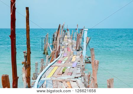 Wooden bridge extended into the sea on samed island