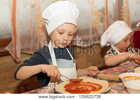 Children Make Pizza. Little Cook.