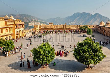 AMER, INDIA - NOVEMBER 18, 2012: Tourists visiting Amer (Amber) fort, Rajasthan, India. Amer fort is famous tourist destination and landmark