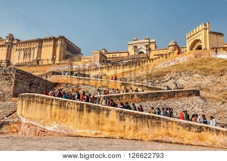 AMER, INDIA - NOVEMBER 18, 2012: Indian tourists visiting Amer (Amber) fort, Rajasthan, India. Amer fort is famous tourist destination and landmark