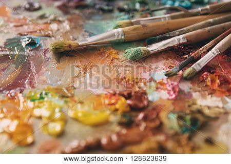 Artist Paintbrushes Over Palette With Oil Colors