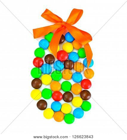 Sweet Bonbons Candy in Easter Egg Form on White Background Studio Photo