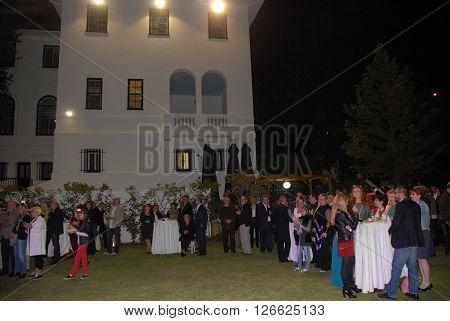 ANKARA/TURKEY-SEPTEMBER 26, 2014: Guests at the garden of British Embassy Ankara during the