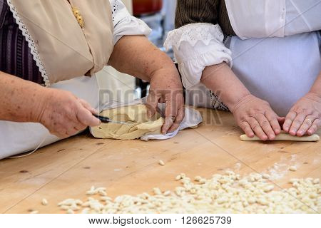 Gnocchi pasta of Sardinia prepared by hand from old cook.