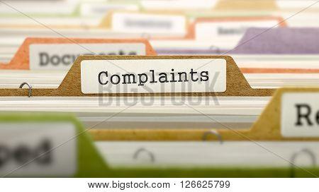 Complaints Concept on File Label in Multicolor Card Index. Closeup View. Selective Focus. 3D Render.