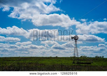 Cloudy Summer Day Windmill on the Prairie