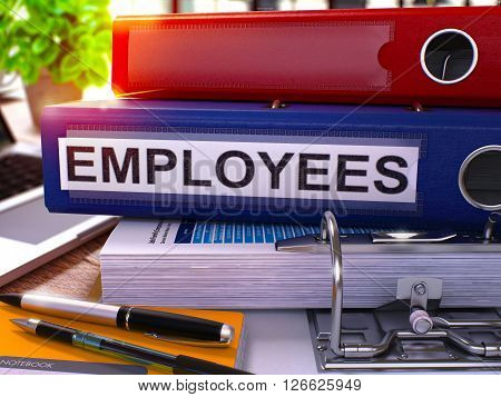 Blue Office Folder with Inscription Employees on Office Desktop with Office Supplies and Modern Laptop. Employees Business Concept on Blurred Background. Employees - Toned Image. 3D Render.