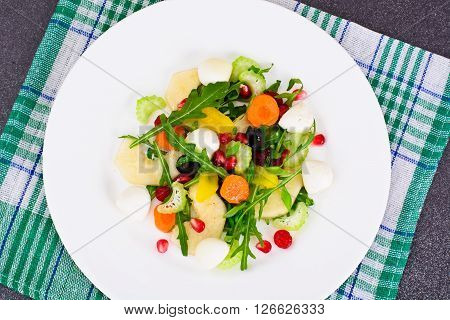 Dietary Delicious Salad on White Plate of Arugula, Par, Walnut and Dried Cherry. Studio Photo