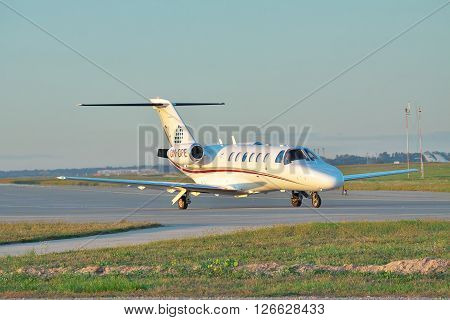 Borispol Ukraine - Septermber 17 2011: Cessna Citation Jet CJ2 business plane taxiing to the runway on sunset