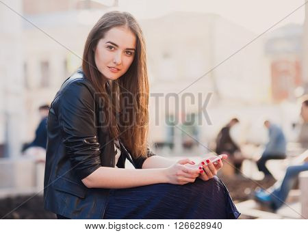 Portrait of a beauty brunette in the city