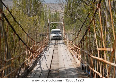 ANKARA/TURKEY-APRIL 6, 2016: White minibus on the old bridge of Nallihan Bird Paradise. April 6, 2016-Ankara/Turkey