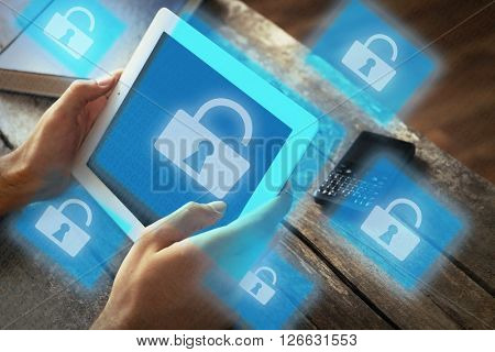 Man working with tablet-pc and icons security on virtual display. Technology, internet and networking concept.