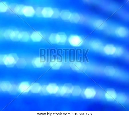 Blurred perl strings shining on blue