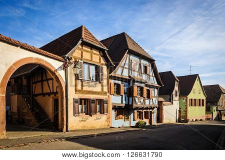Half-timbered houses on a street of St. Hippolyte village, Alsace, France