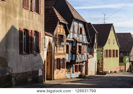 Half-timbered houses on a narrow street of St. Hippolyte, Alsace, France