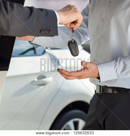Giving a key to the new car