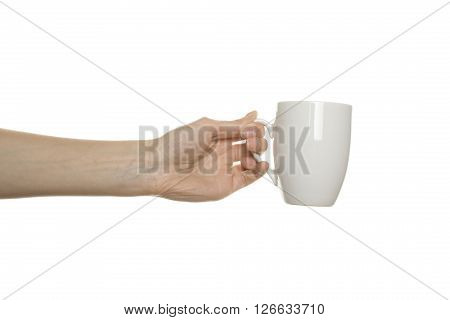 White cup in his hand. Isolated on white background