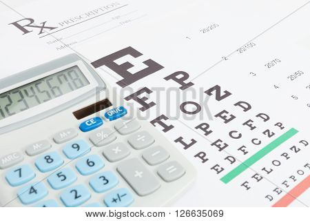 Table For Eyesight Test And Medical Prescription Form With Calculator Over It