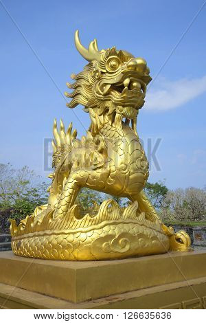 HUE, VIETNAM - JANUARY 07, 2016: The sculpture of the Golden dragon in the Imperial forbidden Purple city. Historical landmark of the city Hue, Vietnam