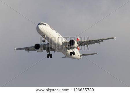 ST. PETERSBURG, RUSSIA - FEBRUARY 17, 2016: Flying Airbus A321-111 (HB-IOF) of the company Swiss International Air Lines, cloudy sky