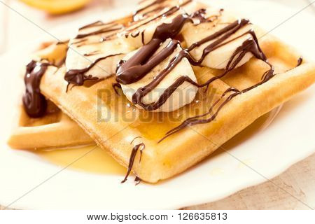Belgium traditional waffels and banana.Selective focus on the front waffel