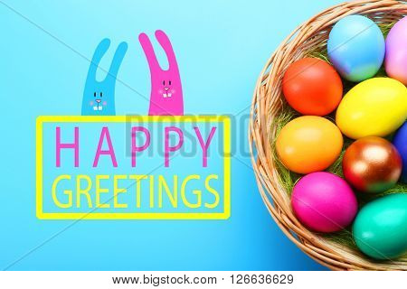 Easter greeting card. Colorful eggs in nest on blue background