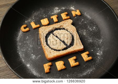 Bread slice in a pan with Gluten Free text.